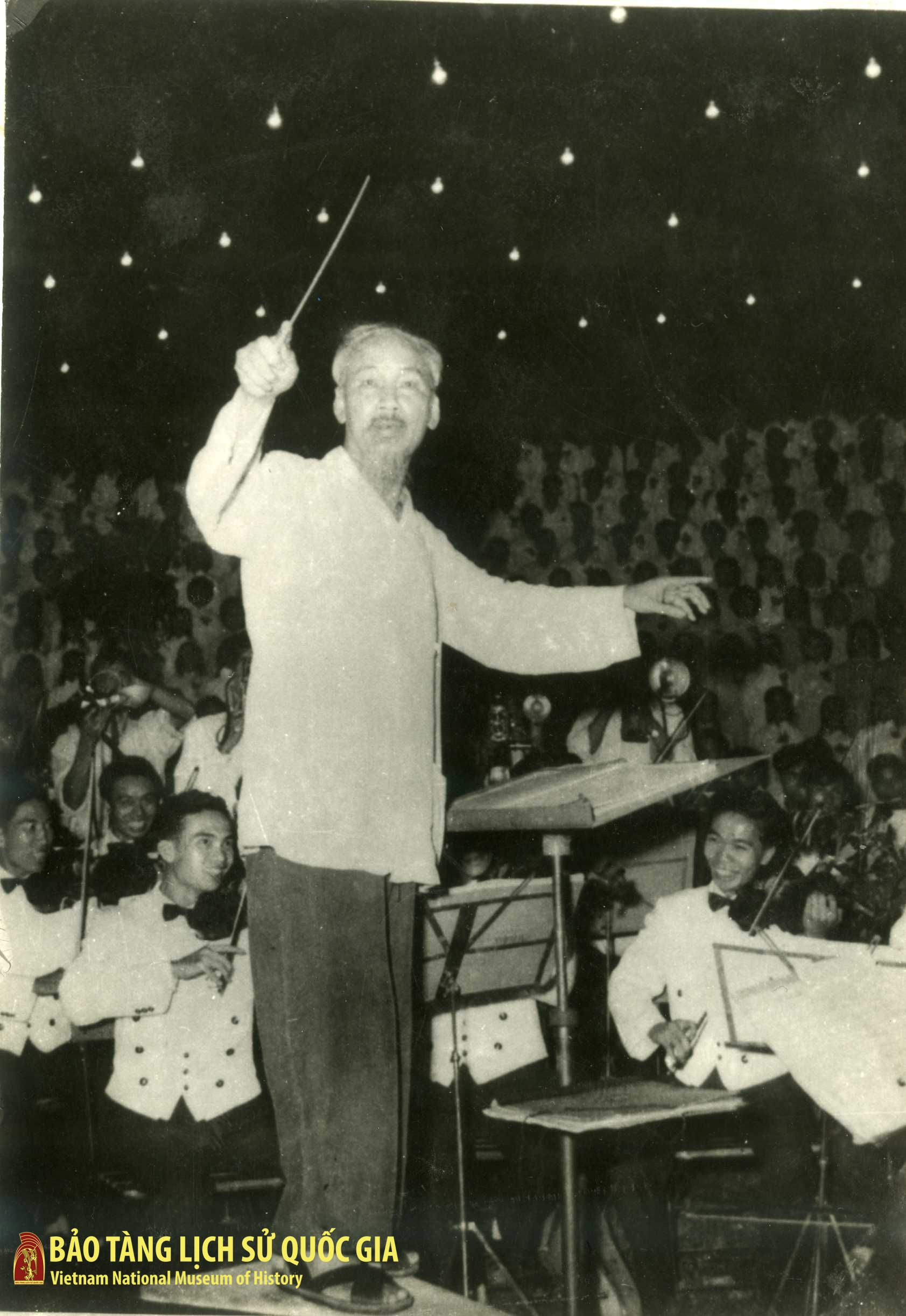 President Ho Chi Minh conducting the national philharmonic orchestra and choir in a performance of the song 'Ket Doan'