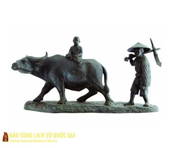 Statue of a farmer plowing